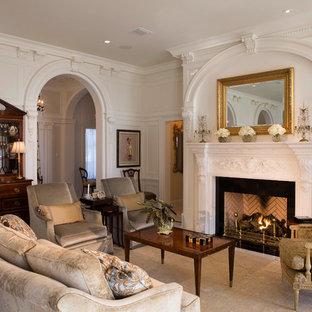 ジャクソンビルの大きいトラディショナルスタイルのおしゃれな独立型リビング (白い壁、標準型暖炉、大理石の床、石材の暖炉まわり、テレビなし) の写真