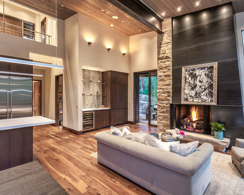 bar in living room. Large contemporary open concept medium tone wood floor and brown living  room idea in Denver 10 Best Living Room with a Bar Ideas Designs Houzz