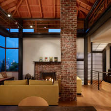 Industrial Living Room by Graham Baba Architects