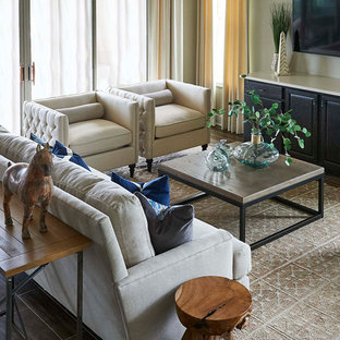 Large transitional open concept carpeted living room photo in Orlando with beige walls, no fireplace and a wall-mounted tv