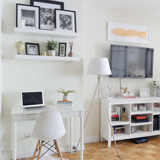 This is an example of a small traditional enclosed living room in New York with white walls.