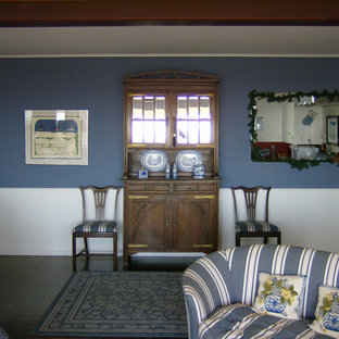 Living room - shabby-chic style dark wood floor living room idea in San Diego with blue walls