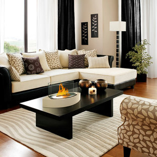 Living room - small living room idea in New York with a two-sided fireplace