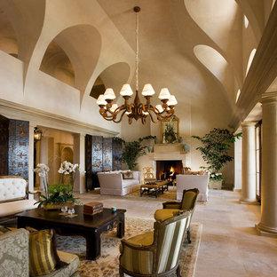 他の地域の巨大な地中海スタイルのおしゃれなLDK (フォーマル、ベージュの壁、標準型暖炉、テレビなし、トラバーチンの床、石材の暖炉まわり) の写真