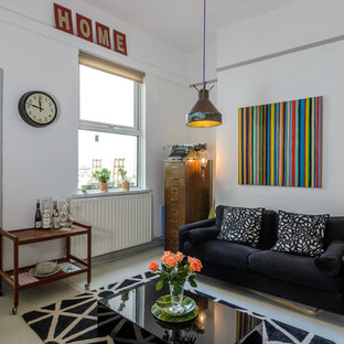 Eclectic living room photo in Belfast with white walls