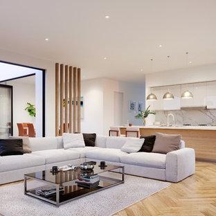 Ispirazione per un soggiorno minimal di medie dimensioni e aperto con pareti bianche, parquet chiaro e pavimento beige