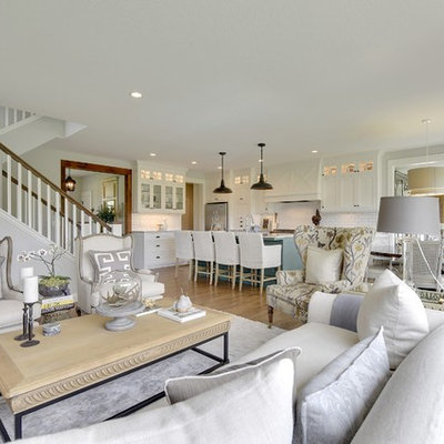Inspiration for a cottage open concept medium tone wood floor living room remodel in Minneapolis with white walls