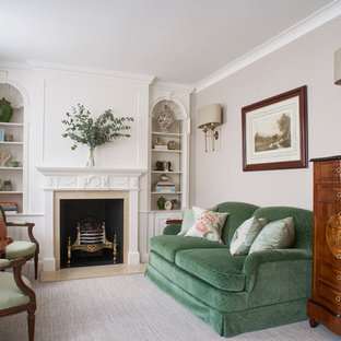 Inspiration for a traditional formal living room in London with no tv, grey walls, carpet, a standard fireplace and grey floors.