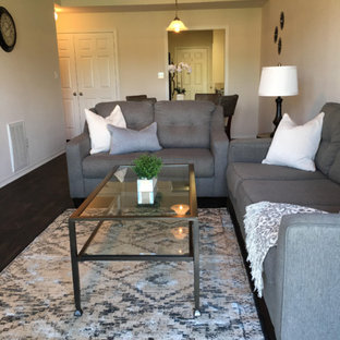 Design ideas for a small traditional enclosed living room in Dallas with grey walls, dark hardwood flooring, no fireplace and brown floors.