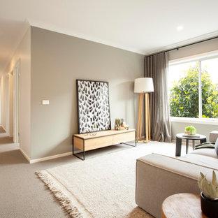 Idéer för industriella vardagsrum, med ett finrum, gröna väggar, heltäckningsmatta och grått golv
