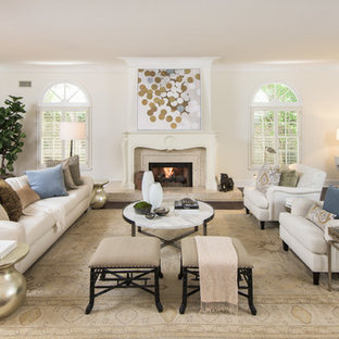 Inspiration for a timeless formal dark wood floor living room remodel in Los Angeles with beige walls and a standard fireplace