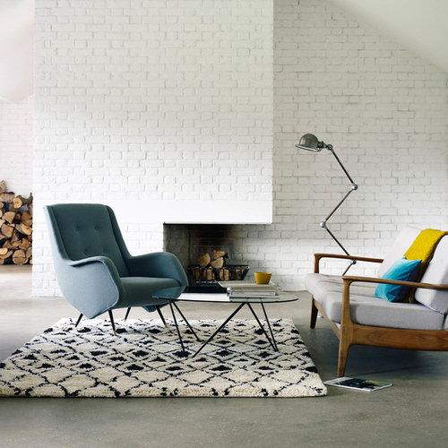 Living room design ideas, renovations & photos with concrete flooring