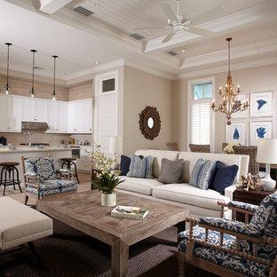 Example of a coastal open concept light wood floor and gray floor living room design in Miami with beige walls