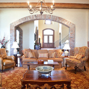 Large traditional open concept living room in Houston with beige walls, medium hardwood floors, a standard fireplace, a brick fireplace surround and a wall-mounted tv.
