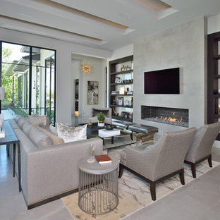 Inspiration for a large modern open concept gray floor living room remodel in Houston with gray walls and a wall-mounted tv