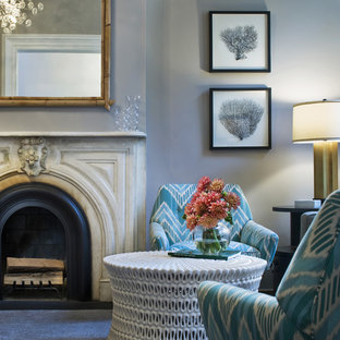 Trendy living room photo in New York with blue walls and a standard fireplace