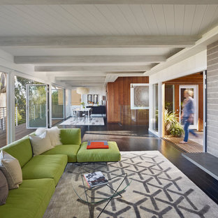 Example of a 1960s open concept living room design in San Francisco