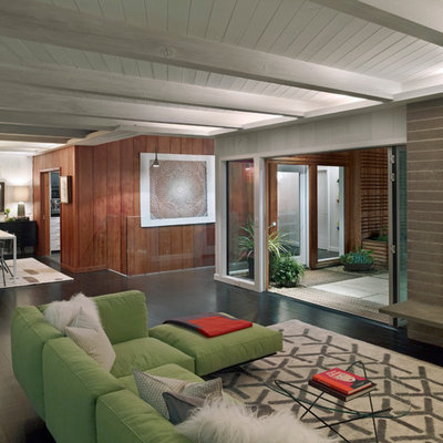 Inspiration for a large modern formal and open concept dark wood floor living room remodel in San Francisco with a concrete fireplace, a standard fireplace and no tv