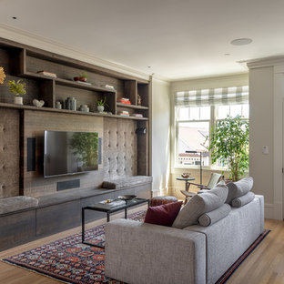 Transitional open concept medium tone wood floor and brown floor living room photo in San Francisco with a wall-mounted tv and beige walls