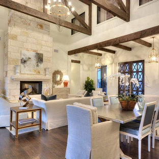 Transitional formal and open concept dark wood floor living room photo in Austin with white walls, a standard fireplace, a stone fireplace and no tv