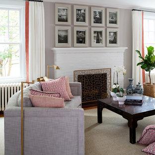ワシントンD.C.の大きいトランジショナルスタイルのおしゃれなLDK (白い壁、標準型暖炉、レンガの暖炉まわり、ライブラリー、淡色無垢フローリング、テレビなし) の写真