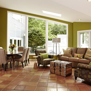 Example of a transitional terra-cotta floor and red floor living room design in DC Metro with green walls