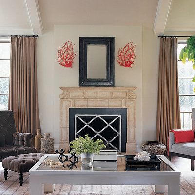 Trendy living room photo in Los Angeles with a standard fireplace