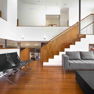 Inspiration for a large contemporary formal and loft-style bamboo floor and brown floor living room remodel in Toronto with white walls