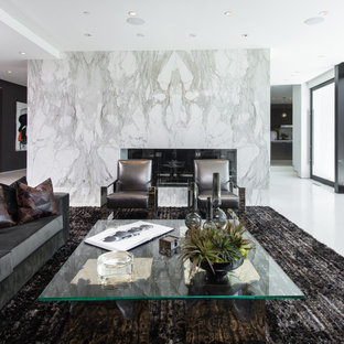 Inspiration for a large contemporary open concept white floor living room remodel in Los Angeles with white walls, a two-sided fireplace and a tile fireplace