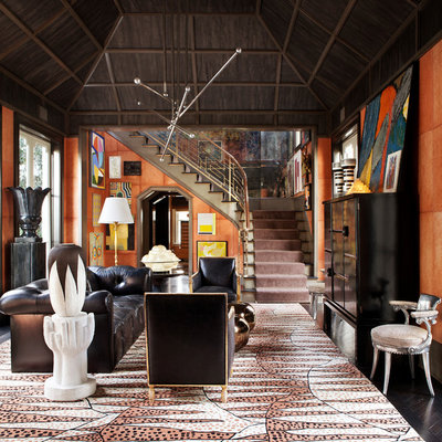 Eclectic formal and enclosed dark wood floor living room photo in Los Angeles with orange walls and no tv