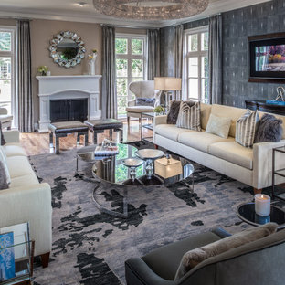Inspiration for a huge transitional formal and open concept light wood floor living room remodel in Houston with gray walls, a standard fireplace and no tv