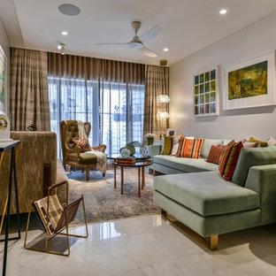 Foto di un soggiorno etnico con pareti bianche, pavimento in marmo e pavimento bianco