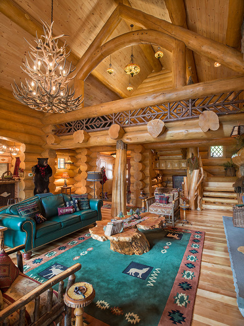 Inspiration for a rustic open concept medium tone wood floor living room  remodel in New York Small Log Cabin Living Room Ideas Photos Houzz