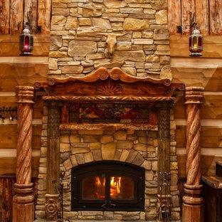 Imagen de salón para visitas tipo loft, de estilo americano, de tamaño medio, sin televisor, con paredes marrones, suelo de baldosas de cerámica, chimenea tradicional, marco de chimenea de piedra y suelo naranja