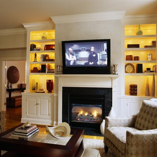 Classic living room in San Francisco with a standard fireplace and a wall mounted tv.