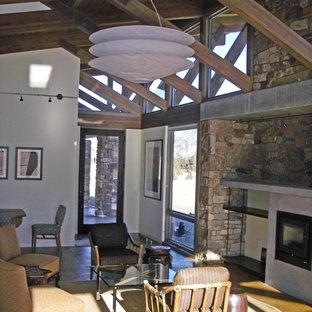 サンフランシスコのラスティックスタイルのおしゃれなLDK (フォーマル、ベージュの壁、セラミックタイルの床、横長型暖炉、テレビなし、黒い床、石材の暖炉まわり) の写真