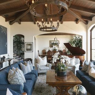 Ejemplo de salón con rincón musical abierto, mediterráneo, grande, con paredes blancas, suelo de madera oscura y suelo marrón