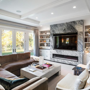 Traditional formal enclosed living room in New York with grey walls, a ribbon fireplace, a stone fireplace surround, a wall mounted tv and black floors.