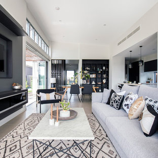 Large contemporary open concept living room in Brisbane with a built-in media wall.