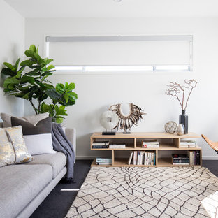 This is an example of a scandinavian living room in Brisbane with white walls, carpet, no tv and grey floor.
