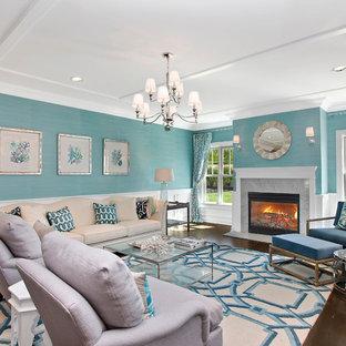 ニューヨークの大きいビーチスタイルのおしゃれなLDK (青い壁、標準型暖炉、テレビなし、フォーマル、濃色無垢フローリング、石材の暖炉まわり、茶色い床) の写真