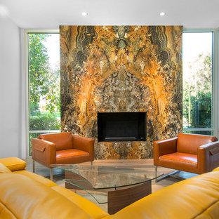 フェニックスの中サイズのコンテンポラリースタイルのおしゃれな独立型リビング (フォーマル、白い壁、淡色無垢フローリング、標準型暖炉、石材の暖炉まわり、テレビなし) の写真