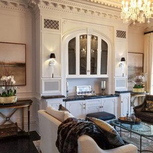 ロサンゼルスの巨大なトラディショナルスタイルのおしゃれなLDK (白い壁、濃色無垢フローリング、標準型暖炉、木材の暖炉まわり、白い床) の写真