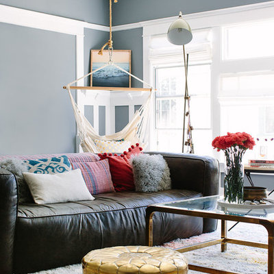 Example of an eclectic living room design in Los Angeles with gray walls