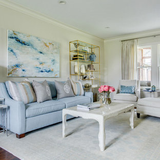 Transitional medium tone wood floor living room photo in Dallas with gray walls