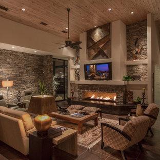 Immagine di un grande soggiorno contemporaneo aperto con pareti beige, pavimento con piastrelle in ceramica, camino lineare Ribbon, cornice del camino in pietra e TV a parete