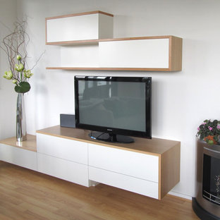 Example of a mid-sized trendy open concept medium tone wood floor living room design in Melbourne with a tv stand, white walls and no fireplace