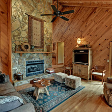 Rustic Living Room by Envision Web