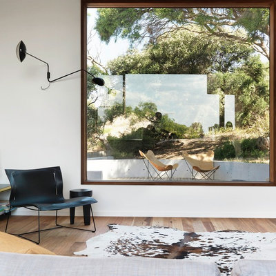 Living room - mid-sized contemporary open concept light wood floor living room idea in Melbourne with white walls