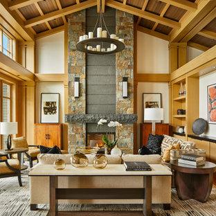 На фото: открытая гостиная комната в стиле современная классика с паркетным полом среднего тона, фасадом камина из камня, балками на потолке, сводчатым потолком, деревянным потолком, бежевыми стенами, стандартным камином и коричневым полом без ТВ с
